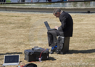 Reporter with Laptop Editorial Stock Photo