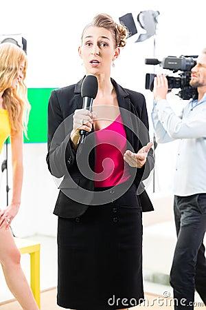 Reporter moderating an interview
