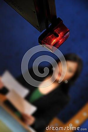 Reporter presenting news in TV studio