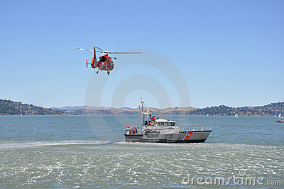 A rescue helicopter and boat