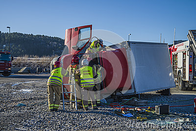 Rescue of an person in a overturned panel van Editorial Photography
