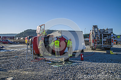 Rescue of an person in a overturned panel van Editorial Stock Image