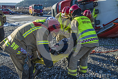Rescue of an person in a overturned panel van Editorial Stock Photo