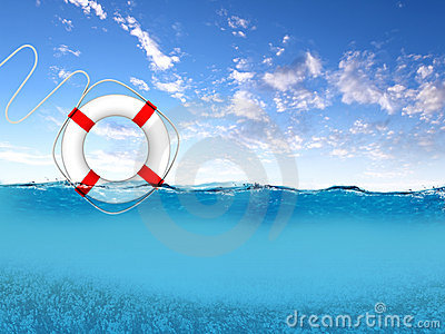 Rescue ring floating on blue waves