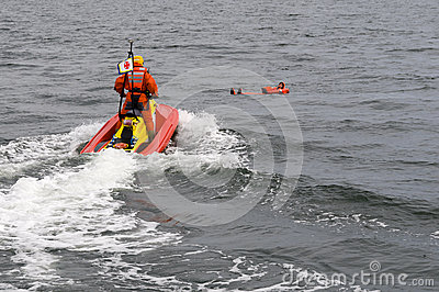 Rescuerunner saving person in water Editorial Stock Image