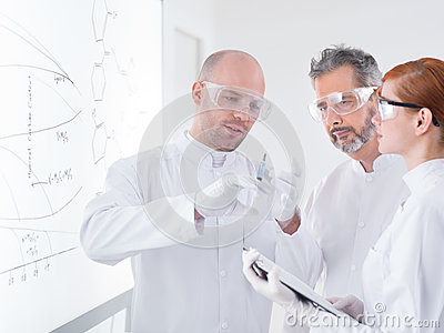 Reseachers preparing an injection
