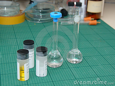 Research lab desk with samples in test-tubes