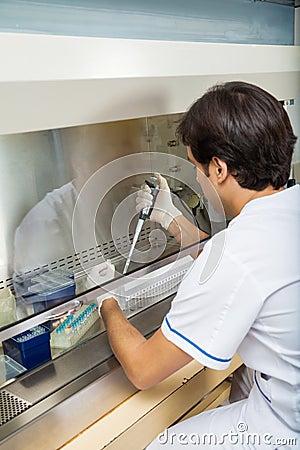 Researcher Filling Solution In Testtube
