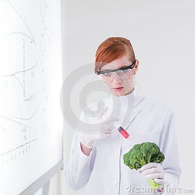 Researcher injecting a broccoli