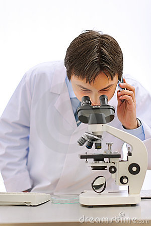 Researcher looking in microscope