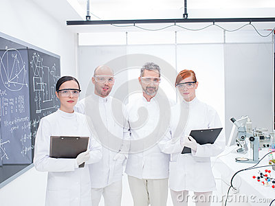 Researchers team in a chemistry lab