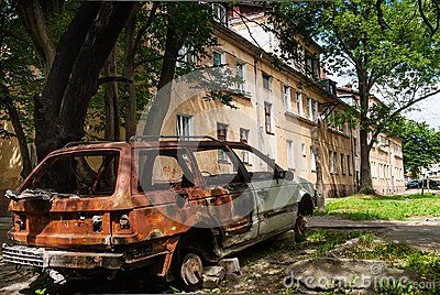 Residental house and burned-down vehicle