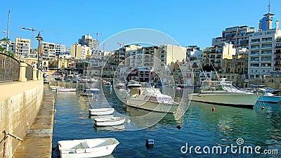 Residential neighborhood at Spinola Bay harbour, St Julians, Malta. ST JULIANS, MALTA - JUNE 20, 2018: Enjoy the walk around Spinola Bay harbour with numerous stock video