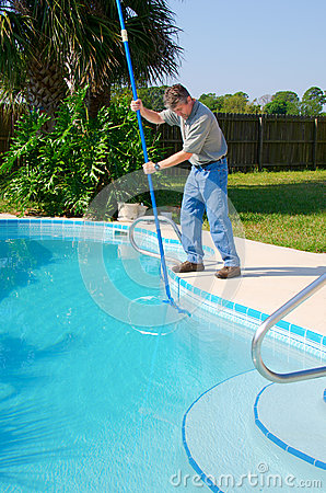 Residential pool cleaning service man working