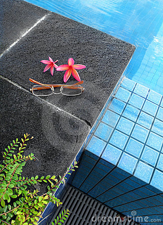 Resort hotel swimming pool, flowers and glasses