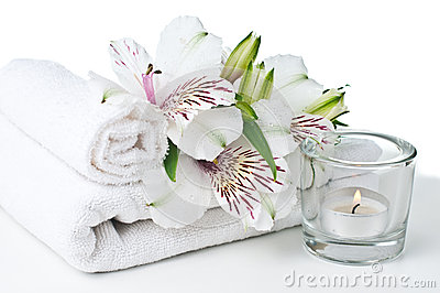 Resources for spa, white towel, candle and flower