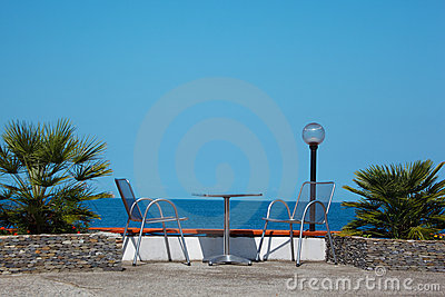Rest on coast. Table and chairs on beach