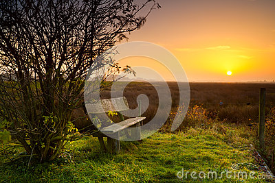 Rest place with bench at sunrise