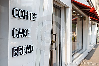 Restaurant cafe with door and window. Caption letters coffee, ca Stock Photo