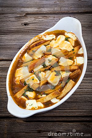 Free Restaurant Delicious Poutine Meal On Table Royalty Free Stock Photo - 112786045