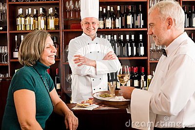 Restaurant manager with staff at wine bar