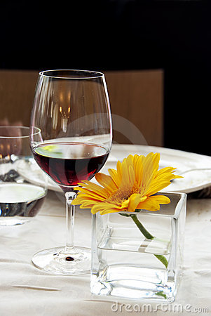 Restaurant table - Red wine and yellow flower