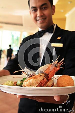 Restaurant waiter holding food