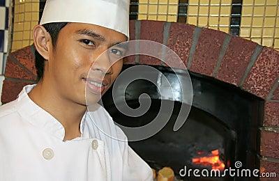 Restaurante da pizza dos cozinheiros chefe