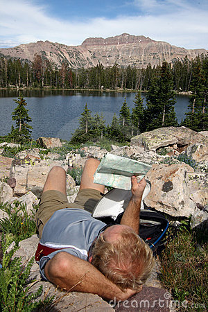 Resting hiker with map
