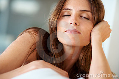 Resting - Relaxed young lady with closed eyes