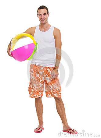 Resting on vacation man with beach ball