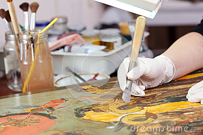 Restoration of  Christian icon with agate burnisher