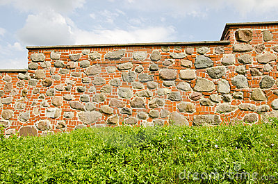 Restored ancient wall made of brick and stones.