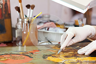 Restorer working on the ancient Christian icon
