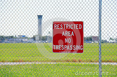 Restricted area no trespassing sign at airport