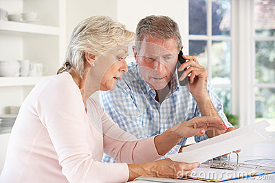 Retired couple with household bills