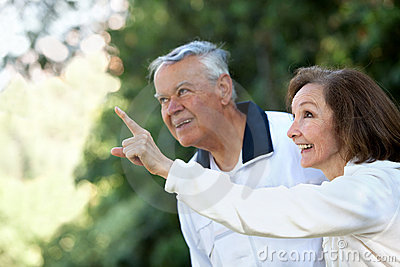 Retired couple looking up