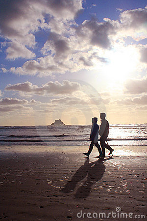 Retired Couple Walking On The Beach Royalty Free Stock