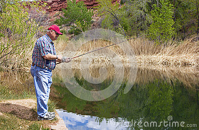 Retired Man enjoying a day of Fishing