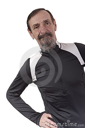 Retired man in exercise clothes posing on white