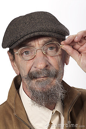 Retired man with glasses and newsboy hat