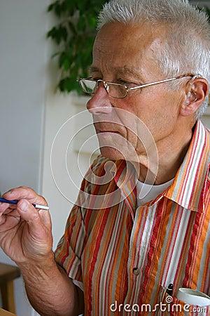 Retired man painting