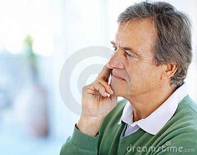 Retired old man lost in deep thought