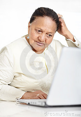 Retired old woman browsing the internet