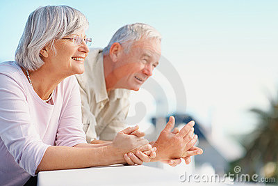 Retired senior couple looking at  copyspace