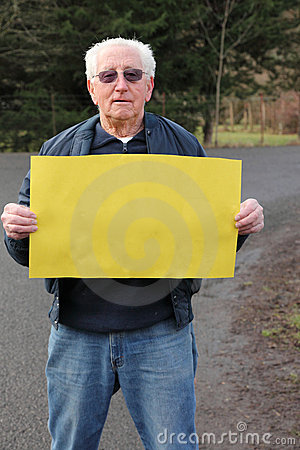Retired senior man with sign and space for text