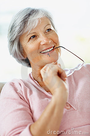 Retired woman deep in thought against white