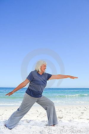 Retired woman doing her stretches