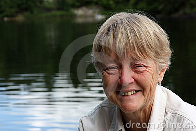 Retired woman at lake