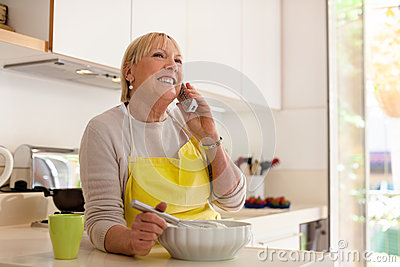 Retired woman preparing food at home